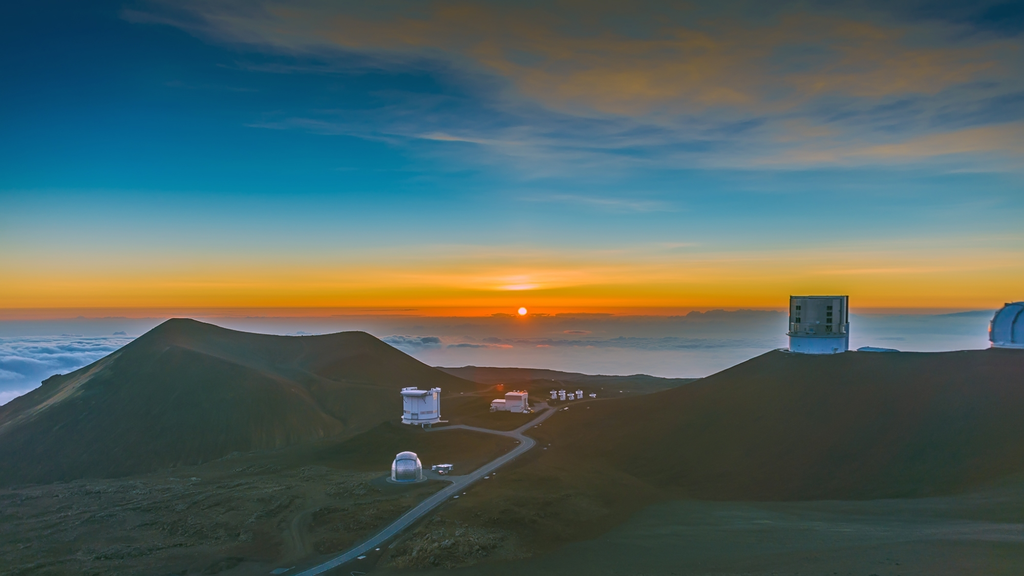 Image shared by OutandSeen.com under a Creative Commons license. Sunset from Mauna Kea